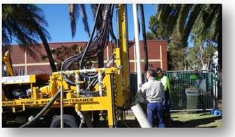 water bore drilling rig drilling on lawn