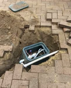Bore drilled in driveway under paving